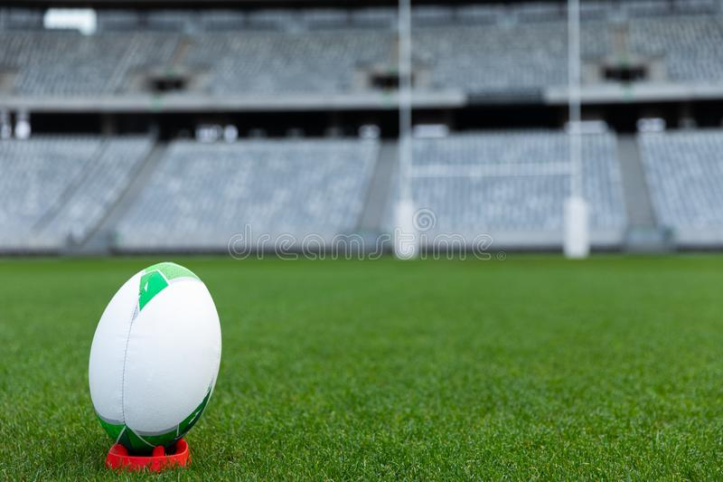 Rugby ball on a stand in stadium. Close-up of Rugby ball on a stand in stadium stock photo