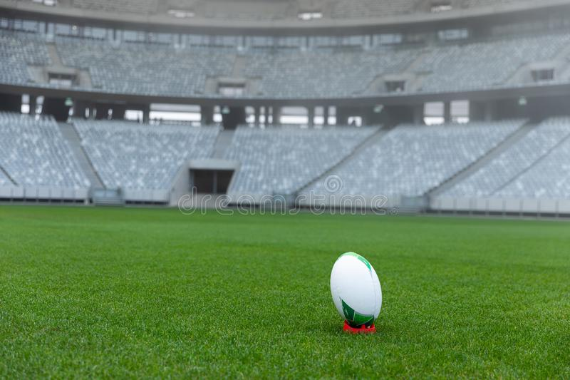 Rugby ball on a stand in stadium. Close-up of Rugby ball on a stand in stadium stock photos