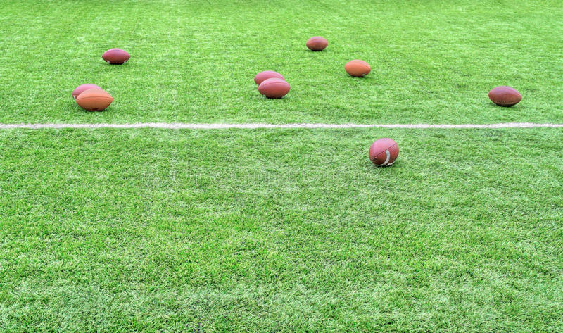 Rugby balls on field royalty free stock photography