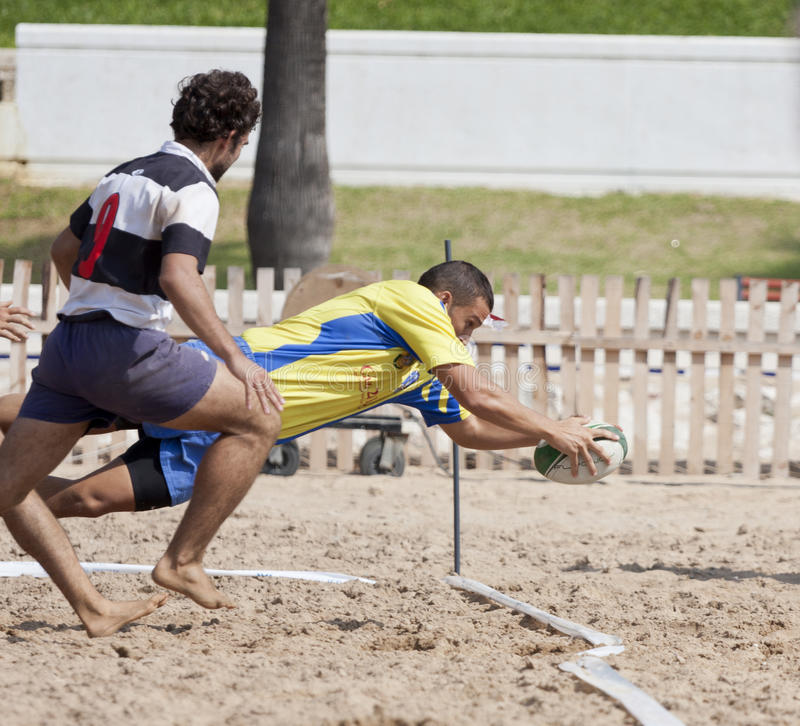 Rugby beach. Annotation in a game of beach rugby stock photography
