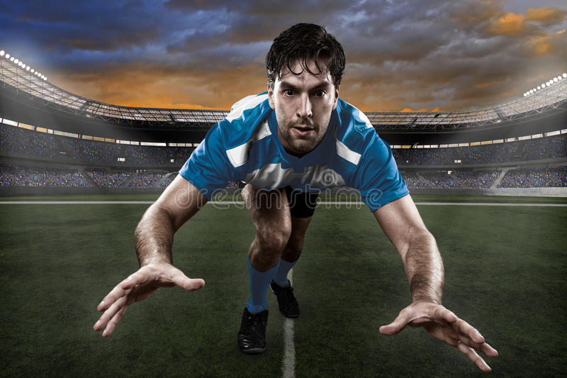 Rugby player. In a blue uniform on a stadium stock photo