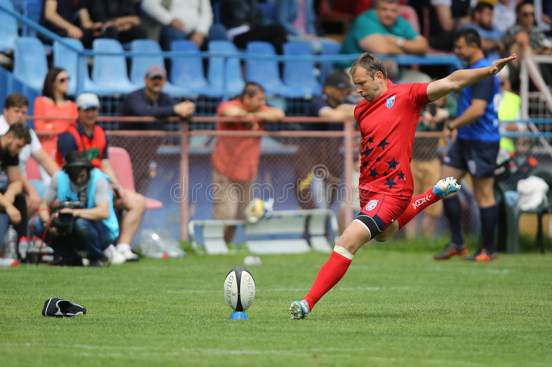 Rugby player kicking the ball stock images