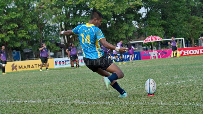 Rugby player making a service at Thailand National Games, 2018 Chiang Rai Games. Chiang Rai, Thailand – November 20, 2018 : Rugby player in action during royalty free stock photography