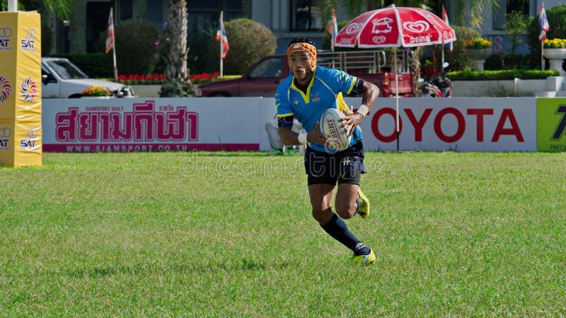 Rugby player making a service at Thailand National Games, 2018 Chiang Rai Games. Chiang Rai, Thailand – November 20, 2018 : Rugby player in action during royalty free stock photo