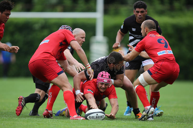Rugby players fighting for the ball royalty free stock image