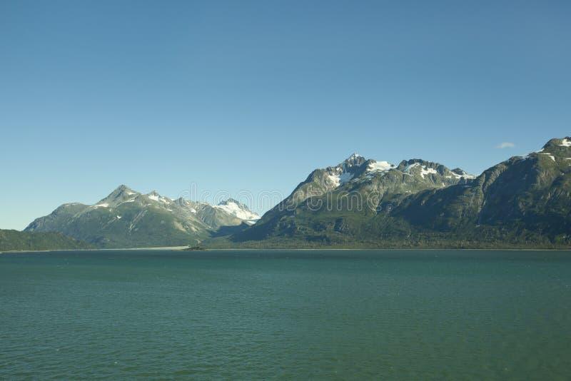 Rugged alaska mountains. And ocean stock image