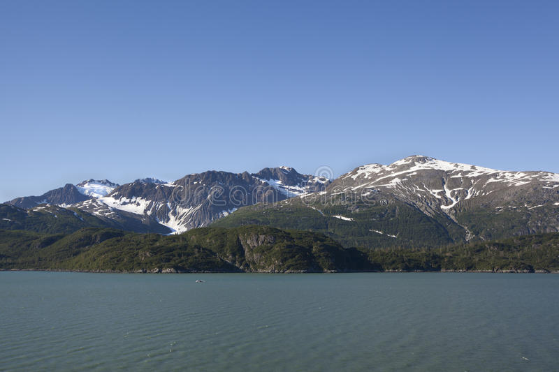 Rugged alaska mountains. With snow stock images