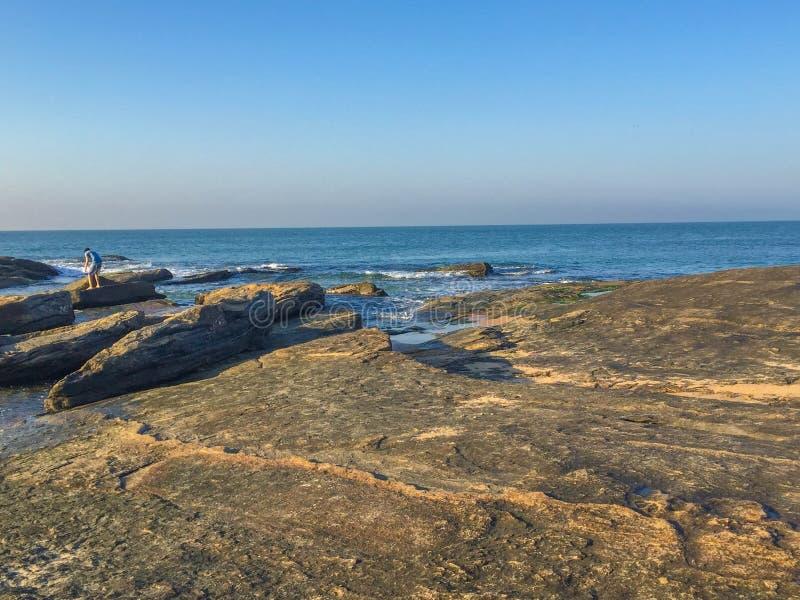 Rugged Beach, Macae, RJ, Brazil. Exploring rockpools on the rugged rocks in Brazil royalty free stock image