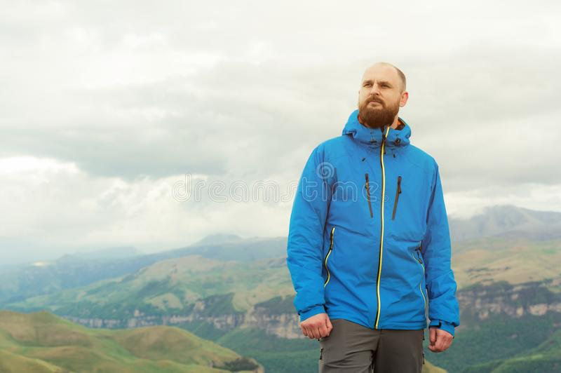 Rugged bearded man in in a membrane jacket headshot country masculine midwest mountain male stock photography