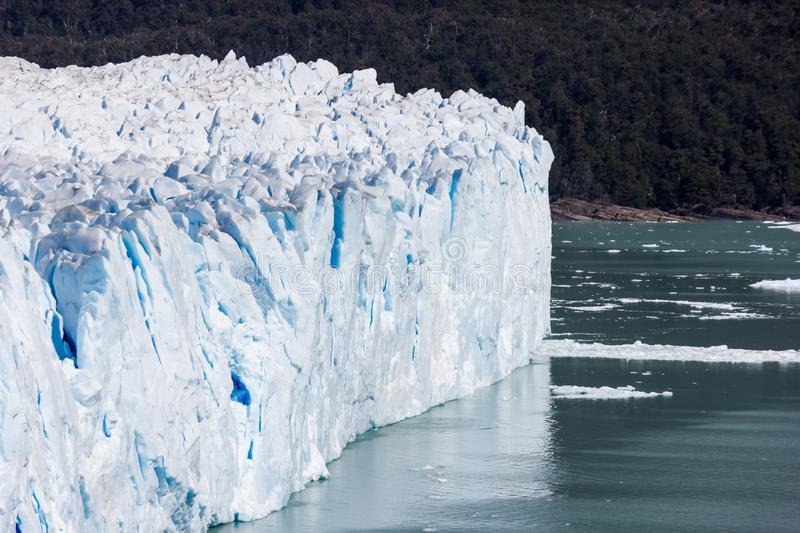 Glacier wall ending in pure water in South America stock photo