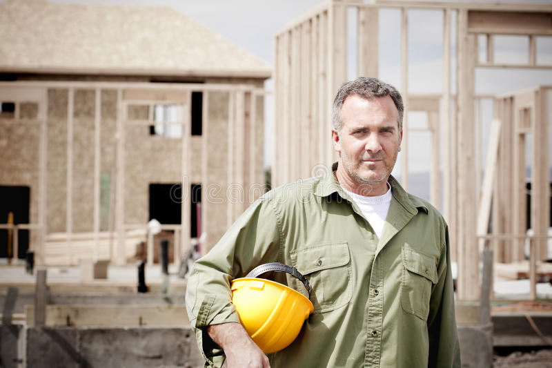 Rugged Male Construction Workers on the jobsite stock photo