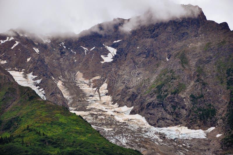 Mountains and ice fields near Hyder, Alaska. Rugged mountains and ice fields in low clouds near Hyder, Alaska stock photos
