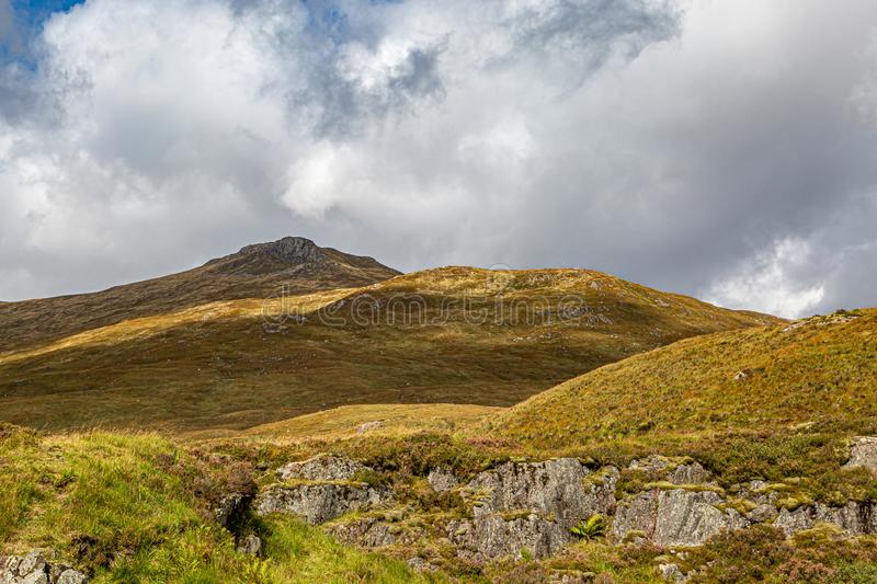 A Scottish Highland View. Rugged mountains in the Scottish Highlands on a sunny late summers day royalty free stock image
