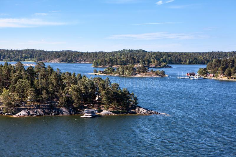 Rugged nature with wooded islands and rocky cliffs in Stockholm archipelago. Uninhabited islets, communities and ancient villages. Rugged nature with wooded stock image