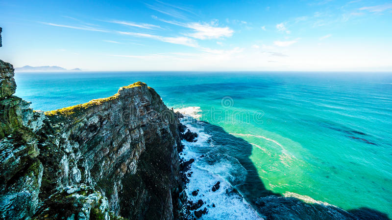Rugged rocks and steep cliffs of Cape Point in the Cape of Good Hope Nature Reserve royalty free stock images