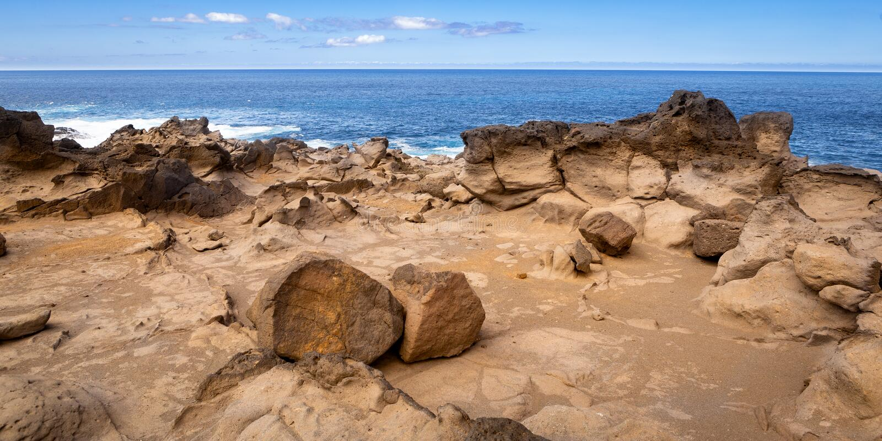 Rugged rocky volcanic coast stock photo