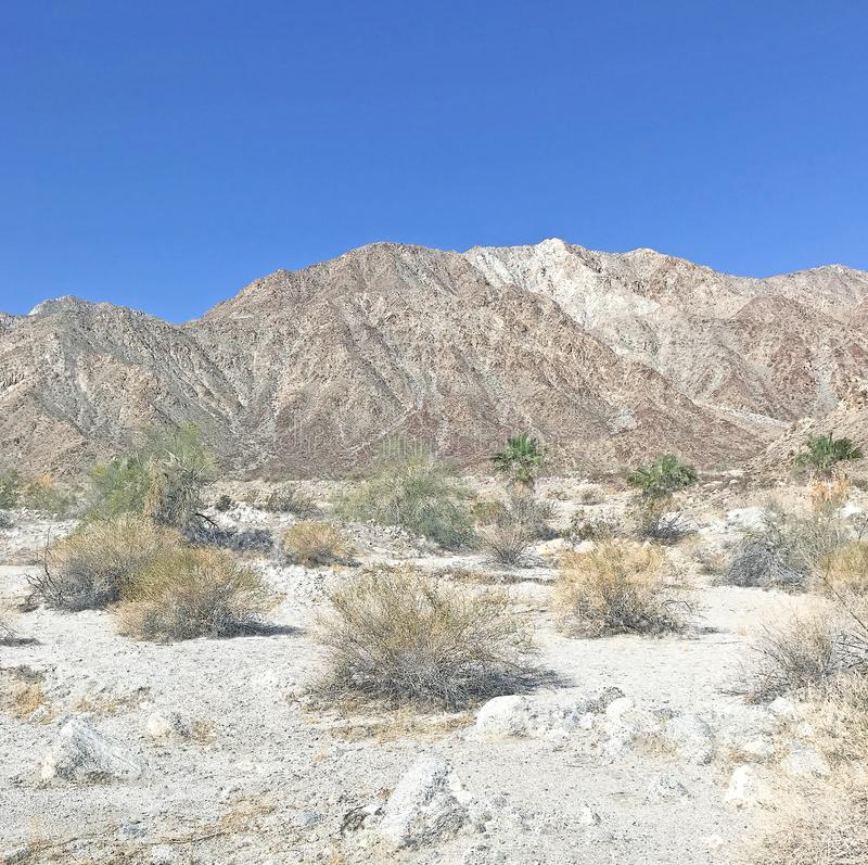 Rugged Terrain Above La Quinta Cove. The La Quinta Cove is a nice, upscale residential enclave in the Coachella Valley with affordable homes. This rugged terrain stock image