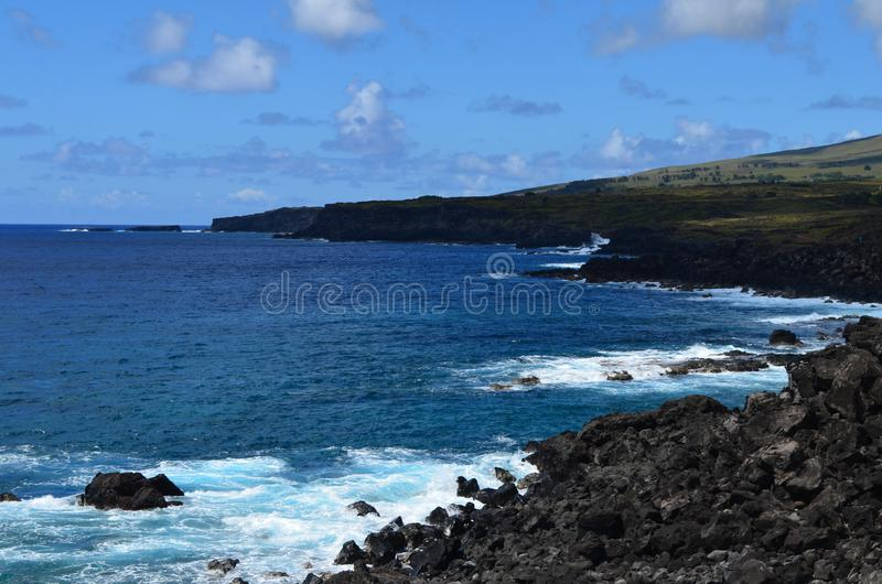 Rugged volcanic cliffs and coastline in Rapa Nui island Easter Island. The triangular-shaped Easter Island, or Rapa Nui, is of volcanic origin and in fact stock photography