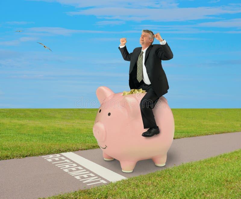 Ruhestandsfinanzplanungserfolgsmann-Reitsparschwein voll des Geldes stockfotografie