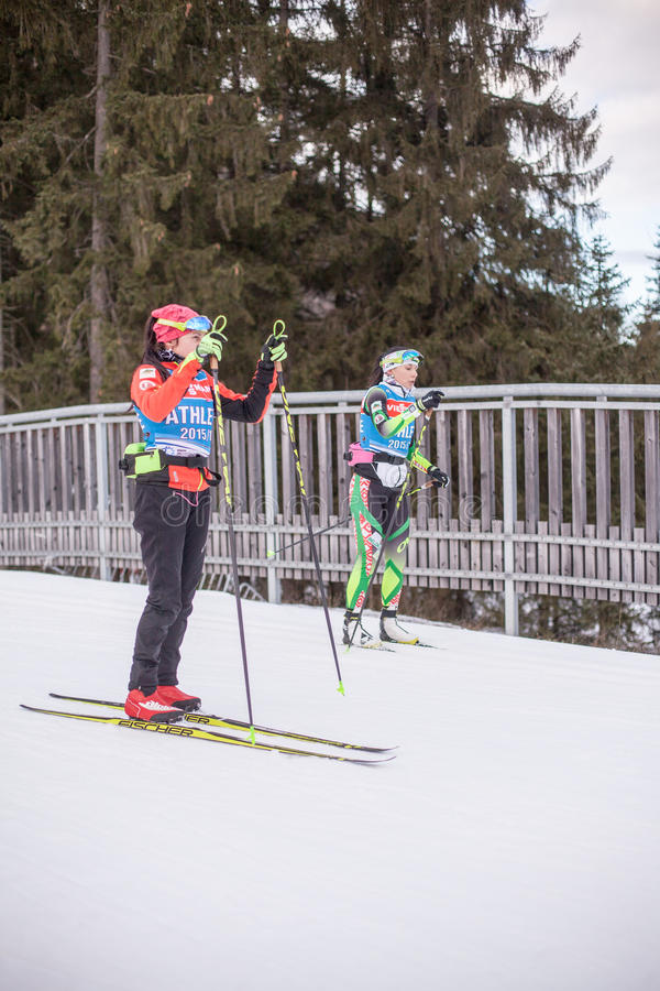 Ruhpolding, Germany, 2016/01/06: training before the Biathlon World Cup in Ruhploding. Ruhpolding, Germany - January 6, 2016: female athletes in ski testing and stock photography