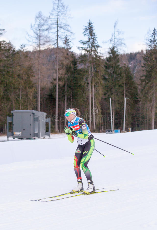 Ruhpolding, Germany, 2016/01/06: training before the Biathlon World Cup in Ruhploding. Ruhpolding, Germany - January 06, 2016: Nadezhda SKARDINO at ski testing stock photography