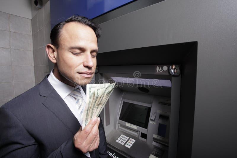 Ruikend geld royalty-vrije stock afbeelding