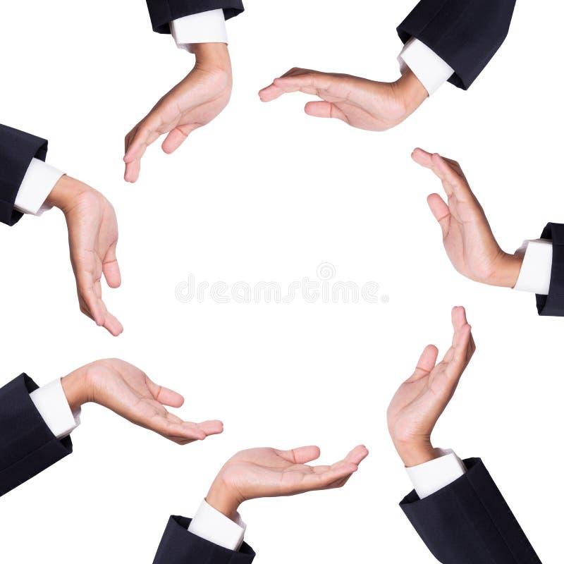 Ruimte tussen vele handen van zakenman stock afbeelding