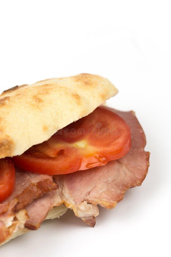 Ruimte van het de tomatenexemplaar van de sandwich somun de gerookte ham stock afbeelding