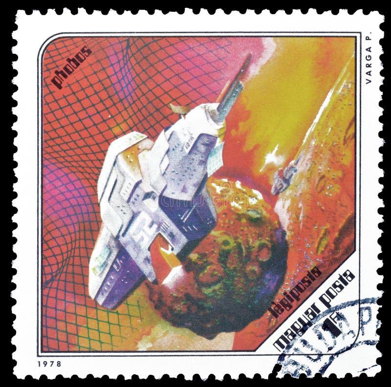 Ruimteexploratie op postzegels stock afbeeldingen