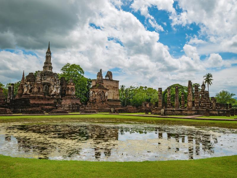 Ruin of ancient Pagoda or stupa in Wat mahathat Temple Area At sukhothai historical park. Ruin of ancient Pagoda or stupa reflection in the water in Wat mahathat royalty free stock image
