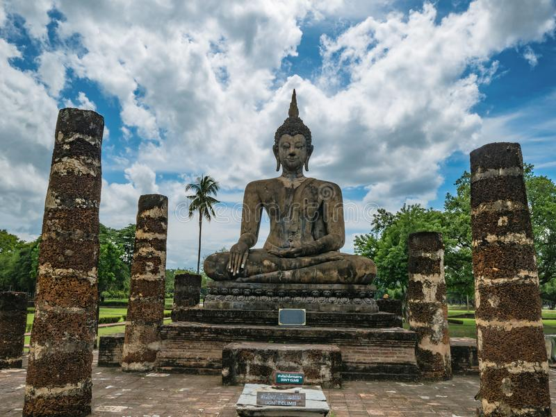 Ruin of ancient Statue and `don `t Climb `Sign in Wat mahathat Temple Area At sukhothai historical park,. Sukhothai city Thailand stock photos
