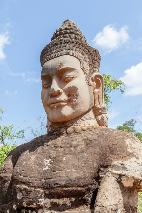 Ruin bayon stone face at gateway of Angkor Wat, Siem Reap, Cambodia. royalty free stock photography