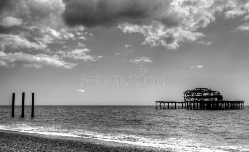 Ruin of Brighton West Pier, United Kingdom. Brighton, United Kingdom - August 25, 2018: Ruin of west pier in Brighton United Kingdom shot in black and white with stock images