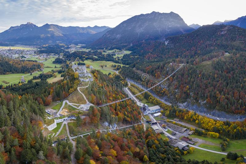 Ruin of castle ehrenberg with rope bridge and fortress klause in reutte tirol. At fall stock photo