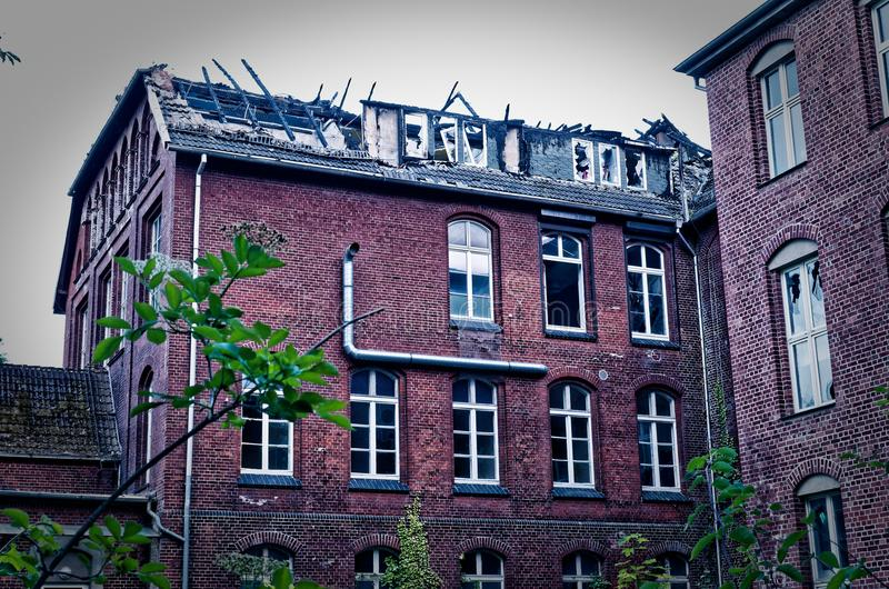 Ruin of a large brick house after a fire in the attic to clarify fire damage Arson theft and vandalism.  royalty free stock image