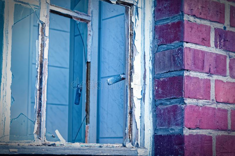 Ruin of a large brick house after a fire in the attic to clarify fire damage Arson theft and vandalism.  stock photo