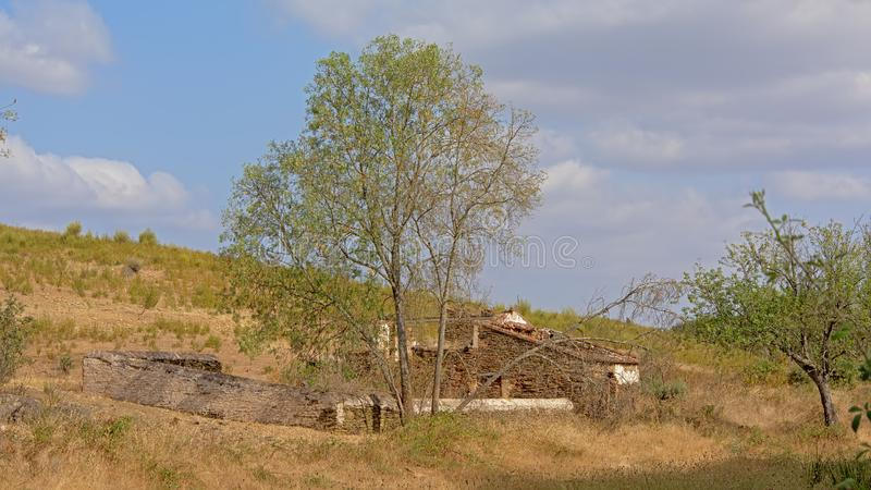 Ruin of an old house in the hills of the Spanish countryside on a suny day with soft clouds royalty free stock image
