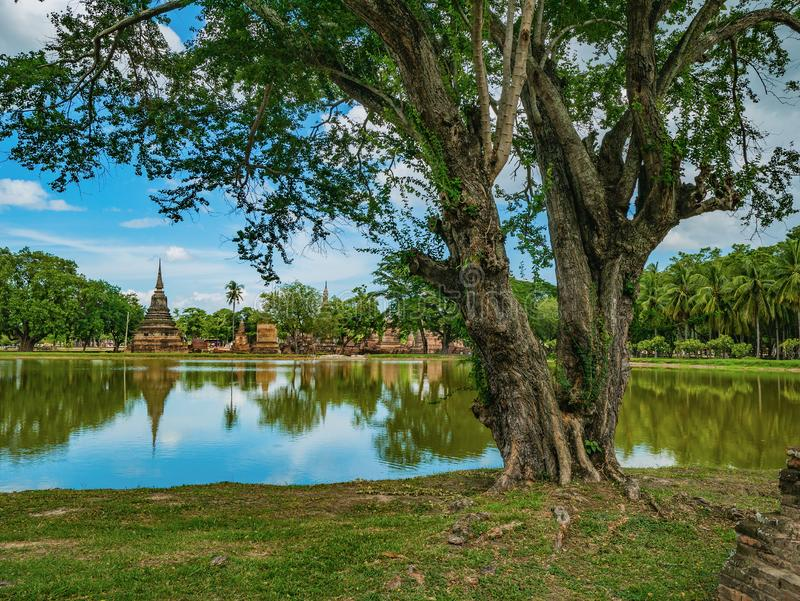 Ruin of Pagoda and statue reflection in the water and nature At sukhothai historical park. Sukhothai city Thailand stock photos