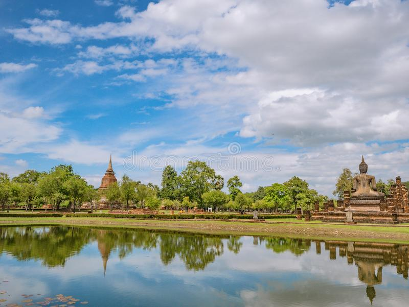 Ruin of Pagoda in Wat mahathat Temple Area and reflection in the water At sukhothai historical park. Ruin of Pagoda and statue in Wat mahathat Temple Area and stock photos