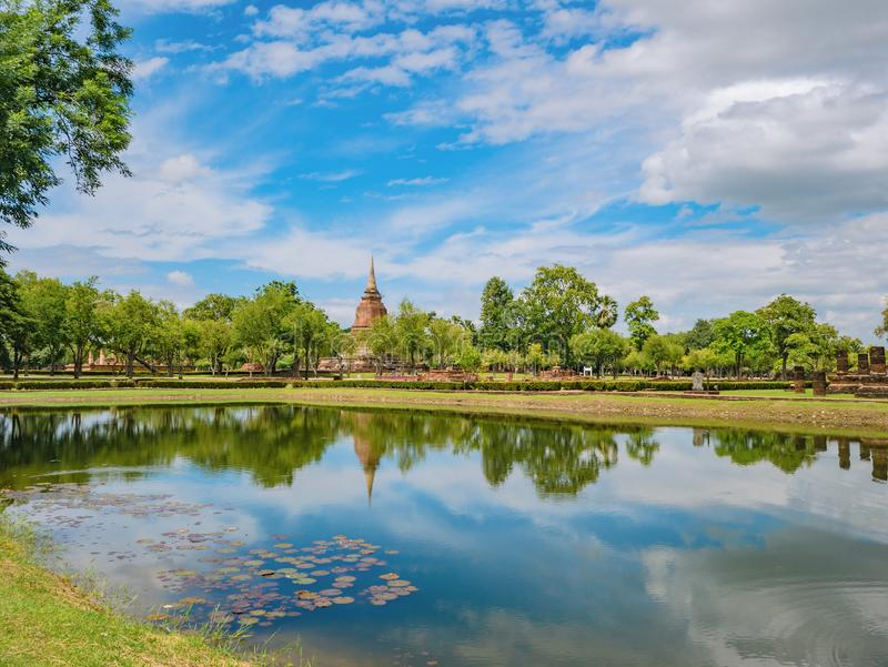 Ruin of Pagoda in Wat mahathat Temple Area and reflection in the water At sukhothai historical park stock photos