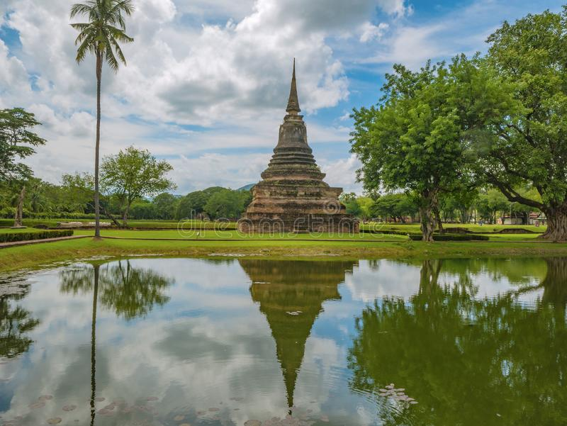 Ruin of Pagoda in Wat mahathat Temple Area and reflection in the water At sukhothai historical park. Sukhothai city Thailand royalty free stock images