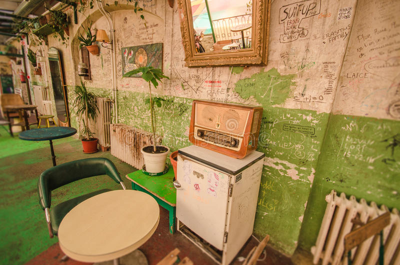 Ruin pubs of Budapest. Budapest, Hungary - Mars 31, 2016: One of the most attractive and touristic ruin pubs, the Szimpla, at Kazinczy street. Ruin pubs, most in stock photos