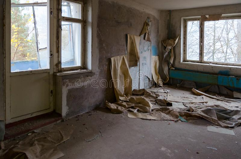 Ruin in room in apartment building in dead abandoned ghost town Pripyat, Chernobyl NPP exclusion zone, Ukraine stock image