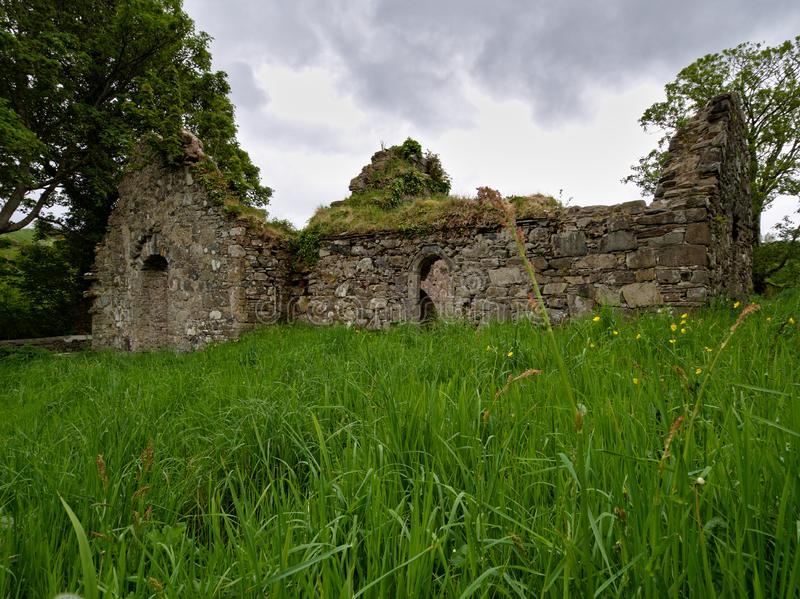Ruined St. Catherine`s friary in Killybegs, County Donegal, Ireland. The ruin of St. Catherine`s friary in the town of Killybegs, Co. Donegal, built ca. 1535 for royalty free stock photography