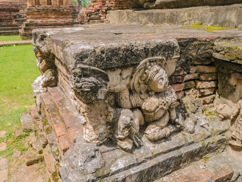 Ruin of Statue om Wat mahathat Temple Area at sukhothai historical park. Sukhothai city Thailand stock image