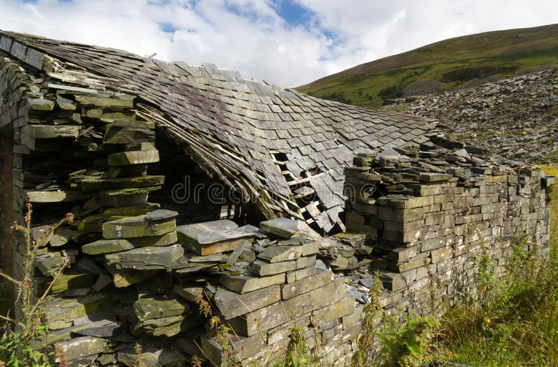 Ruin of stone cottage, United Kingdom. Derelict stone building, collapsing roof, Snowdonia, Wales, United Kingdom royalty free stock image