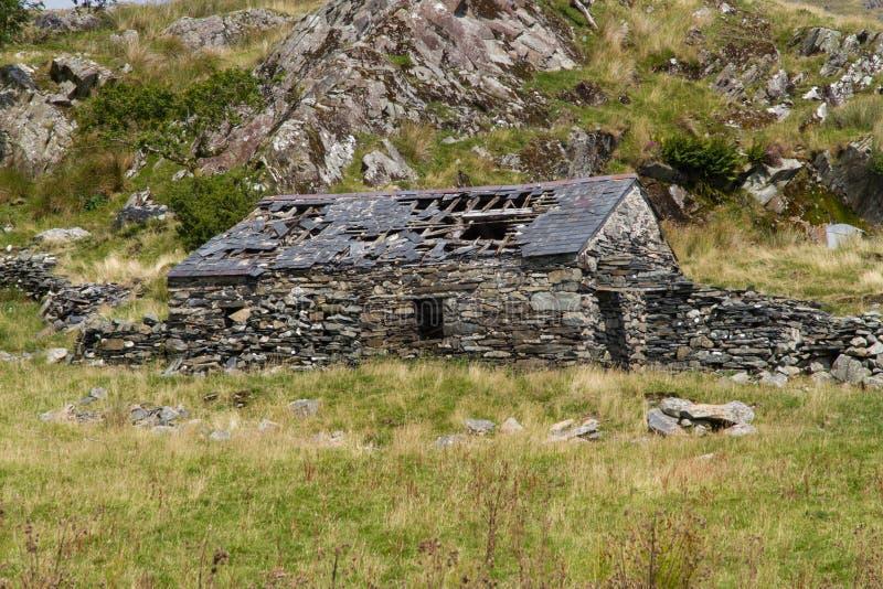 Ruina de la cabaña de piedra, Reino Unido foto de archivo
