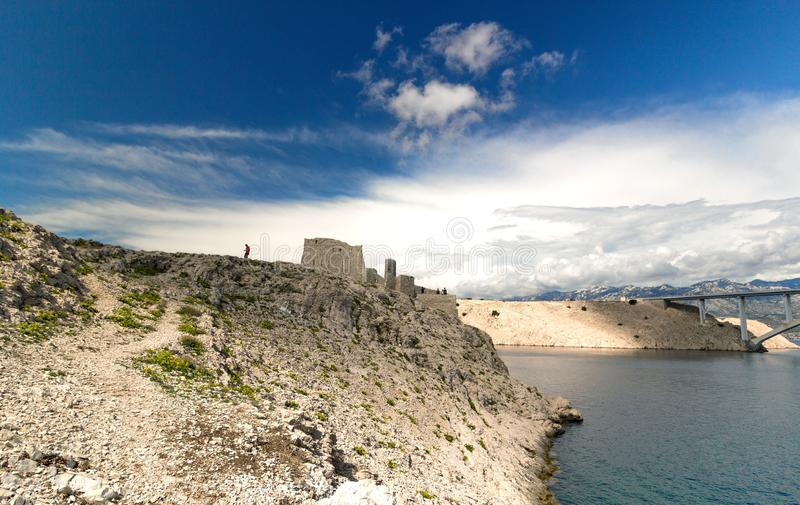 Ruine of fortress and the Pag bridge, Island of Pag, Croatia royalty free stock image