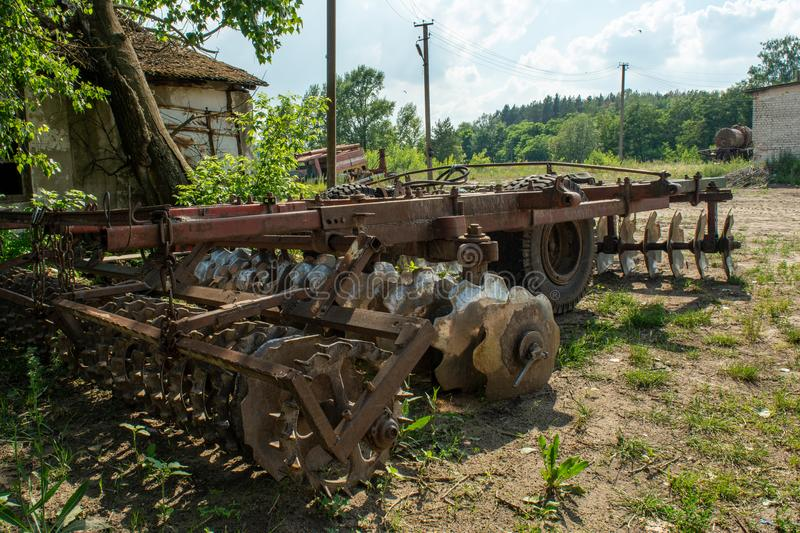 Ruined abandoned agriculture complex during summer in the lost forgotten village. In Ukraine stock images