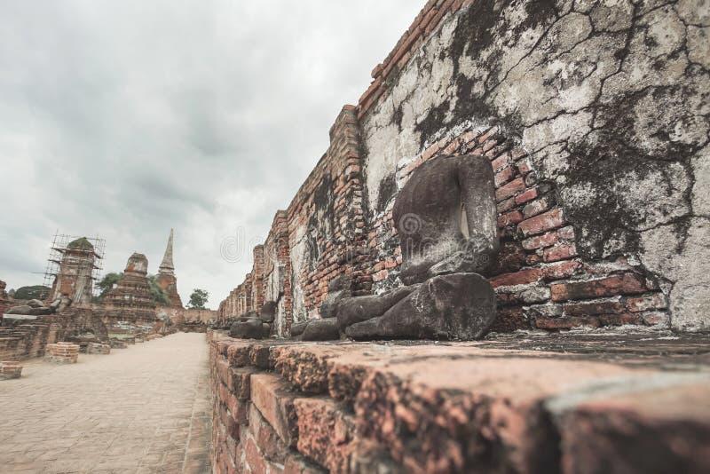 Ruined Buddha statue in Wat Mahathat, Ayutthaya, Thailand. royalty free stock photos